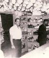 "Photograph of ""Bill"" at the inside bar of Gilbert's Liquor Store"
