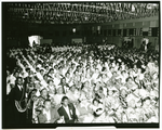 Masons and members of the Order of the Eastern Star seated in large banquet hall