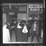 "Three suspects being taken into custody after riot between ""Muslim"" sect and police in Los Angeles, Calif., 1962"