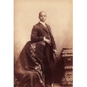 African-American man in formal dress with a cane