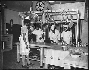 """...WAAC cooks prepare dinner for the first time in new kitchen at Fort Huachuca, Arizona."""