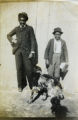 Two African American boys with a dog
