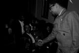 Richard Boone shaking hands with a man during a meeting at First Baptist Church in Eutaw, Alabama.