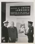 "Artist Jacob Lawrence, with United States Coast Guard Captain Joe S. Rosenthal and photographer Carl Van Vechten, at his painting exhibition, ""Paintings by Jacob Lawrence: Migration of the Negro & Works Made in the U.S. Coast Guard,"" in New York City, 1941"