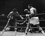 Richard Pryor boxing with Muhammad Ali in a ring