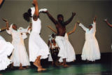 Group of dancers with a drummer