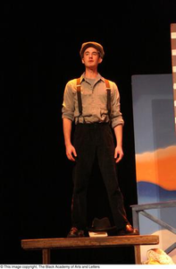 Actor dressed as immigrant Ellis Island