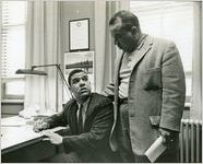 Hamilton E. Holmes, one of the first two African-American students to integrate the University of Georgia (seated), with his father Alfred Holmes, Athens, Georgia, January 9, 1961.