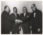 Richard J. Daley with Father George Clements and others