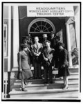 [Walter White, left, and Ike Smalls, surrounded by Third Officers (clockwise from left) Mildred E. Carter, Elizabeth C. Hampton, Harriette B. White, Glendora Moore, Evelyn F. Greene, Dovey M. Johnson, and Doris M. Norrel, at the WAAC Training Center, Fort Des Moines]