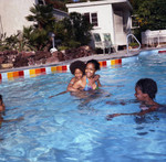 Iris Gordy and children in the pool at Berry Gordy's party, Los Angeles