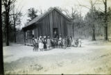 African American children gathered in front of a building