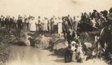 African American woman being baptized in a creek.
