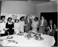 Seven African-American women schoolteachers with a white male supervisor at a luncheon sponsored by Davison-Paxon Company, Atlanta, Georgia, April 15, 1955. [Afro-American] School Teachers' Luncheon
