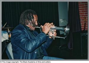 Photograph of a man facing the audience and playing trumpet Hip-Hop Soul Cabaret
