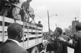 Andrew Young speaking to photographers at Martin Luther King, Jr.'s funeral.