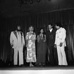 Miss Black America Beauty Pageant performers The 5th Dimension standing on stage, Atlantic City, 1972