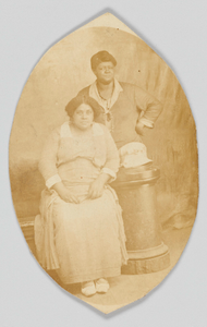 Photographic postcard of two unidentified women
