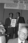 Black Enterprise Magazine's Earl G. Graves receiving a proclamation from Tom Bradley, Los Angeles, 1987