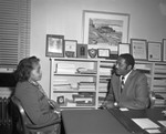 Ida L. Jackson, the first African American teacher for the Oakland Unified School District with Supt. Dr. Marcus Foster [picture]