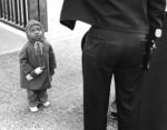 Child looking at police officer