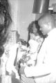Susie Sanders Hubbard and her new husband, Freddie, opening gifts in a bedroom of her parents' home in Montgomery, Alabama, during their wedding reception.