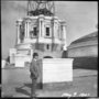 Cass Gilbert standing before partially completed State Capitol dome