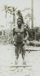 Man in stocks, Congo, ca. 1900-1915