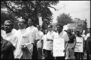 Protesters at a civil rights and fair housing demonstration: 'Stop Jim Crow'