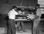 Men in workshop, Los Angeles, 1968