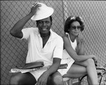 Sidney Poitier and Freda Payne prepare for tennis, Los Angeles, ca. 1976