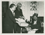 Mrs. Emma English declared Mother of the Year by New Jersey Civil Rights Congress, receiving gifts from Mr. Joseph Collins, community leader, Trenton, and Mrs. Remel Roberson, church leader and newspaperwoman, May 1950