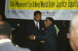 Jesse Jackson greeting Joseph Lowery at the annual meeting of the Southern Christian Leadership Conference (SCLC) in Birmingham, Alabama.