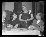 Negro Nite Life on Central Avenue..Series, clubgoers seated around table in Los Angeles, Calif., 1938