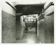 Boy standing in a hallway at Carver Elementary School.