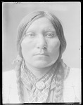 Eagle House of Ogalala Sioux, wearing button of Buffalo Bill 1904