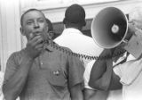 """Floyd McKissick addressing a crowd in front of the Neshoba County Library in Philadelphia, Mississippi, during the """"March Against Fear"""" begun by James Meredith."""