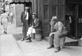 Three African American men outside a store in Montgomery, Alabama.