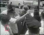WALB newsfilm clip of Reverend Ralph D. Abernathy leading a kneel-in and being arrested in Albany, Georgia, 1962 July 27
