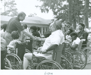 Photograph of Georgia governor Jimmy Carter shaking hands with patients at the Georgia Warm Springs Foundation, Warm Springs, Meriwether County, Georgia, 1973