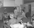 Student standing at the teacher's desk in a classroom at Goodwyn Junior High School at 209 Perry Hill Road in Montgomery, Alabama.