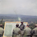 Officer instructing soldiers outside at the U.S. Army training facility at Fort McClellan near Anniston, Alabama.
