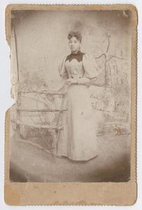 Unknown African American Woman by Fence