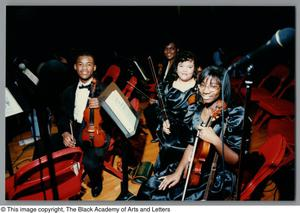 Photograph of students posing with their instruments Christmas/Kwanzaa Concert Hallelujah Hip Hop Concert, December 1995