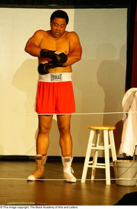Thumbnail for Vincent Cook Putting on Boxing Gloves on Stage Ali...The Man, The Myth, The People's Champion