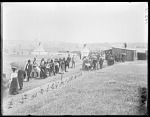 Group of Indians and whites entering fair grounds. U. S. Indian School, St Louis, Missouri 1904