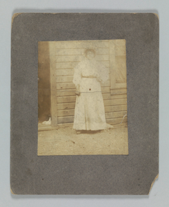 Thumbnail for Photographic print of a woman in front of a building