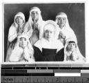Portrait of a Korean Sister sitting with five girls wearing white veils, Korea, ca. 1920-1940