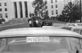 """Alabama Militia Volunteers"" decal on a car parked in front of the Capitol in Montgomery, Alabama, during a visit by Attorney General Robert Kennedy."