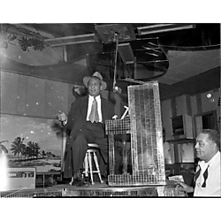 Woogie Harris seated at mirrored piano, with bartender Tom West on left, in Crawford Grill No. 2